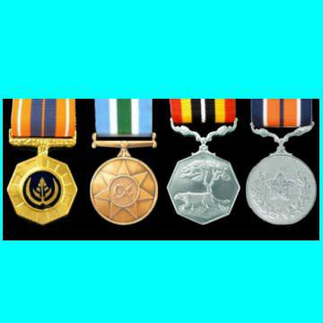Grouping of 4 full size medals with ribbons: pro patria,