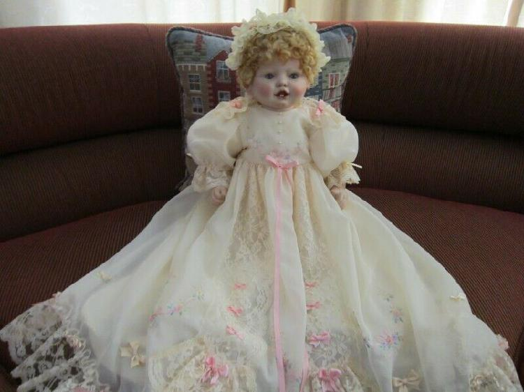 Handcrafted porcelain doll.