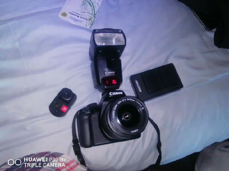 Canon 4000D camera with 18-55mm lens, on top flash and its