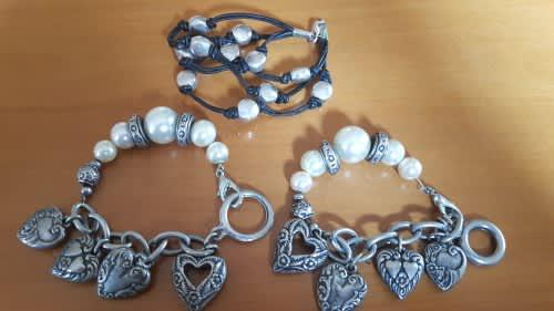 Three childrens fashion bracelets: two charm bracelets and