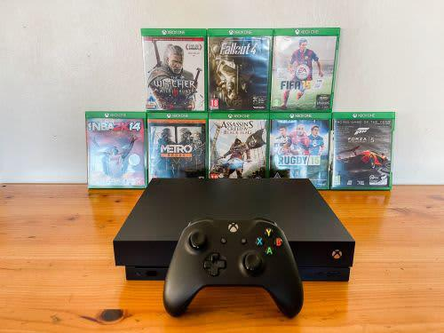 Xbox one x 1 controller and 8 games great condition! free