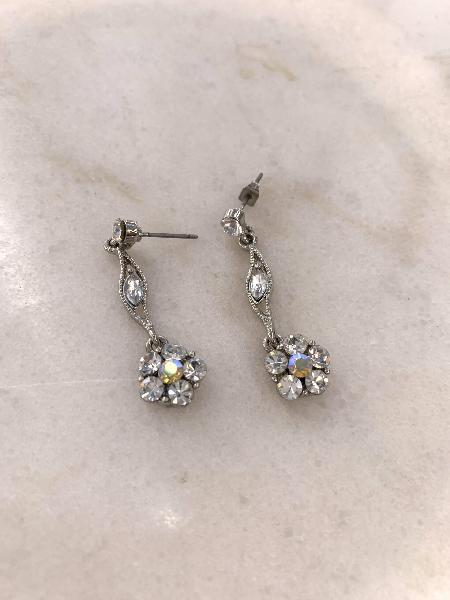 Silver colour drop earrings with white stones in flower