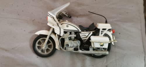 Old 80`s manufactured 1:18 police kawazaki motorcycle