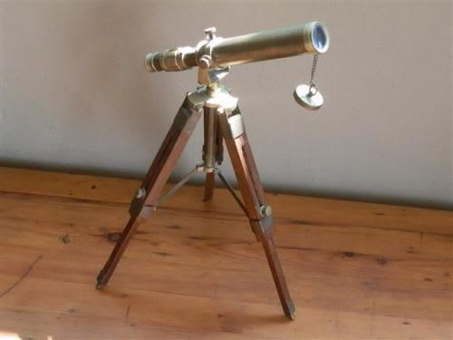 Old brass telescope on wood and brass tripot sales sample -