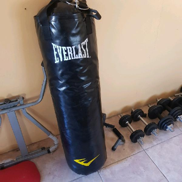 Punch bag with wall brackets and gloves. as new..